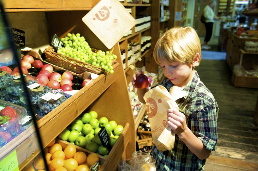 young-customer-choosing-fruit