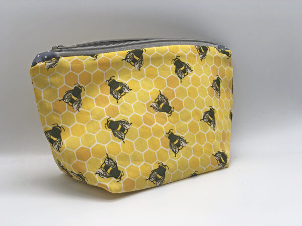 fabric make up bag in yellow and grey bee print